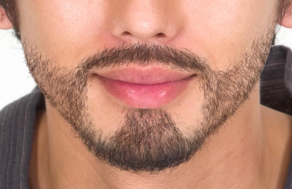 髭を描画した男性